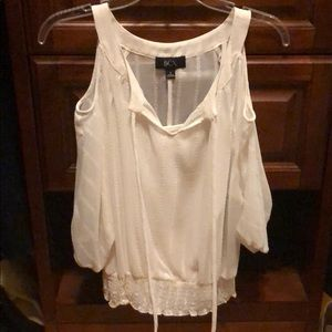 White BCX shirt. Cami attached under sheer top